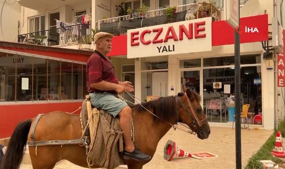 Milas'ta boşaltılan yerlere atıyla gelip eczane aradı