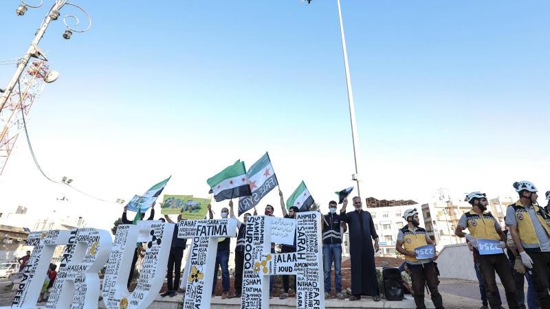 İdlib'te Doğu Guta katliamı protestosu